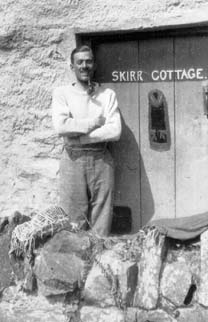 HW outside Skirr Cottage, 1921